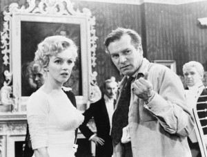 1957, London, England, UK --- Original caption: London, England: Sir Laurence Olivier, co-star and director of the film, emphasizes a point for actress Marilyn Monroe on the set of their movie