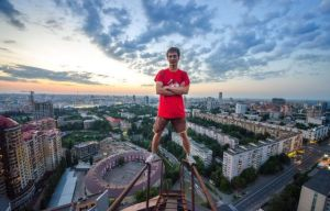 One of Yaroslav Segeda's friends on top of a tall building in Kiev. (Photo by Yaroslav Segeda/Solent News)