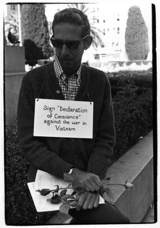 Man with rose and petition at Union Sq