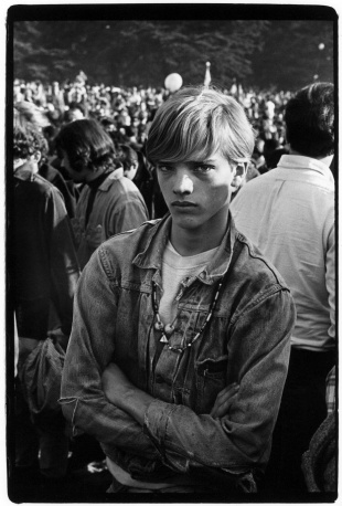 Young man in crowd at concert