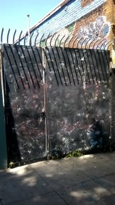 The metal wall I built to keep people from climbing the fence