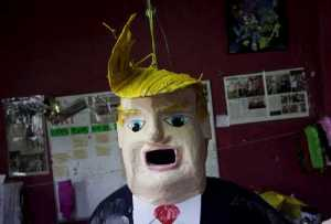 A pinata depicting U.S. Republican presidential candidate Donald Trump hangs outside a workshop in Reynosa, Mexico, June 23, 2015. Days after billionaire Trump accused Mexico of sending criminals to live in the United States, a Mexican artisan has given angry Mexicans an outlet-- a Trump pinata they can stuff with candy and beat with a stick. In the Mexican border city of Reynosa, Dalton Ramirez works at his family's pinata shop where they create a variety of paper mache figures to be filled with treats and broken open with sticks on birthdays and holidays. Picture taken June 23, 2015.  REUTERS/Daniel Becerril   - RTX1HZH9