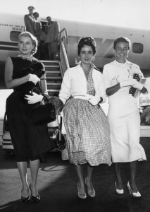 Grace Kelly, Elizabeth Taylor, and Laraine Day arriving at the New York International Airport, 1954