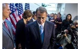 Speaker of the House Rep. John Boehner, R-Ohio, walks away from the microphone during a news conference after a House GOP meeting on Capitol Hill on Tuesday, Oct. 15, 2013 in Washington. The federal government remains partially shut down and faces a first-ever default between Oct. 17 and the end of the month. (AP Photo/ Evan Vucci)