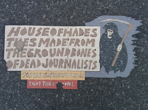 House_of_Hades_Toynbee_tile_at_11th_and_1st_in_New_York_City_January_2014