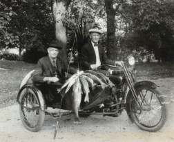 William A. Davidson (in sidecar) and William S. Harley show their catch made on Pine Lake in 1924