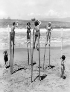 Four young women playing volleyball on stilts, Venice, California, June 1934