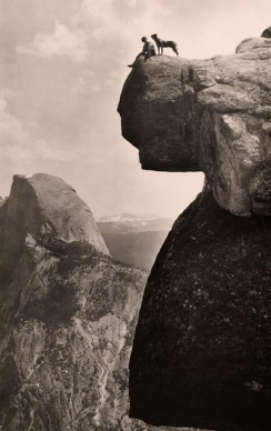 A man and his dog on the Overhanging Rock in Yosemite National Park, California, 1924