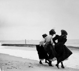 Hiking their skirts at the shoreline of the beach in Arverne, Queens, New York, 1897