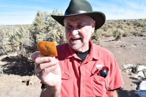 Brian Jennings holds a multi-tool thought to be roughly 15,800 years old.