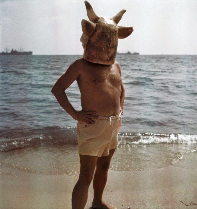 Pablo Picasso in a Minotaur mask