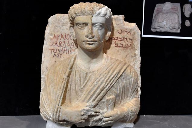 A picture taken on February 16, 2017 shows a restored bust, one of the two funeral reliefs from Palmyra at the Higher Institute of Conservation and Restoration (ISCR - Istituto Superiore per la Conservazione ed il Restauro), in Rome. The busts of a man and a woman, dated from the 2nd and 3rd century AD and destroyed by the Islamic State group (IS), have been entrusted to the care of the technical and restorers of the ISCR in Rome. By the end of this month, they will be returned to their place of origin. Alberto PIZZOLI / AFP