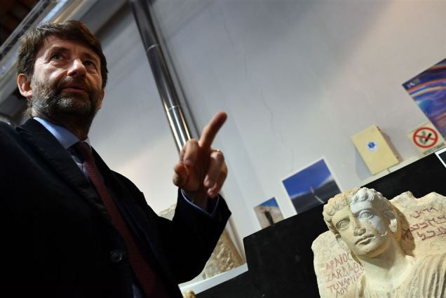 Italian Minister for Cultural Heritage, Activities and Tourism Dario Franceschini males an appropriate gesture to ISIL as he speaks in front of a restored bust, which is one of the two funeral reliefs from Palmyra archeological site that will be restored at the Higher Institute of Conservation and Restoration (ISCR - Istituto Superiore per la Conservazione ed il Restauro) in Rome, on February 16, 2017. The busts of a man and a woman, dated from the 2nd and 3rd century AD and destroyed by the Islamic State group (IS), have been entrusted to the care of the technical and restorers of the ISCR in Rome. By the end of this month, they will be returned to their place of origin. Alberto PIZZOLI / AFP