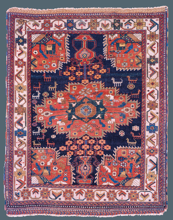 "Afshar, Southwest Persia, Late 19th C., 4'0"" X 5'6"" Afshar, Southwest Persia, Late 19th C., 4'0"" X 5'6"" Afshar, Persia. Mid 19th c. 3' 5"" x 4' 4"" Afshar, Persia. Mid 19th c. 3' 5"" x 4' 4"" Published: ""Oriental Rugs from Pacific Collections"", Murray L. Eiland, 1990. Page 79, plate #46. During the 19th century, the central medallion format, complete with complimentary corner pieces, was generally a design of large, formal workshop carpets. The nomadic weaver of this Afshar rug was inspired by the classic layout, but transformed it with her native, vibrantly colorful aesthetic. She dispensed with the classical formality, and instead focused on the purity of naturally derived color and added charmingly drawn animals to roam the indigo field. This rug exemplifies the true spirit of Afshar weaving."
