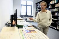 Judaica Research Centre chief Lara Lempertiene shows a map and an advertising poster